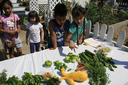 Kids sharing their vegetables with the community