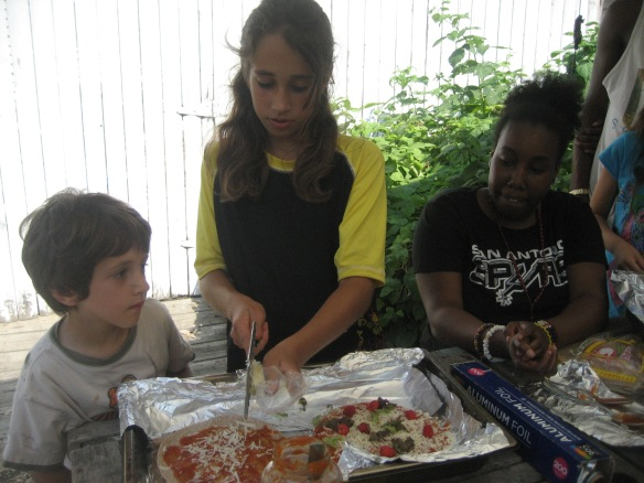 The kids picked herbs and other foods growing in the Children's Garden to add to their pizzas.